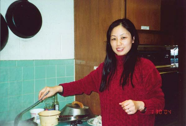 Yan Bing Zhang helps cook dumplings for the Lunar New Year party.